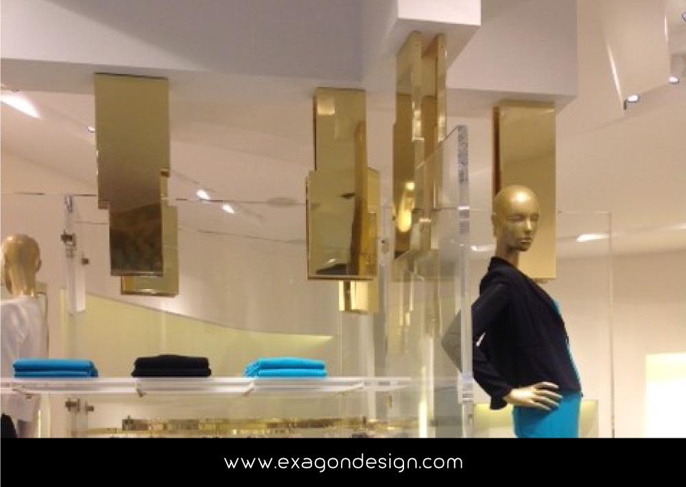 Versace-Tblisi-shop-flying-wardrobe-plexiglas-and-brass-exagon-design_03