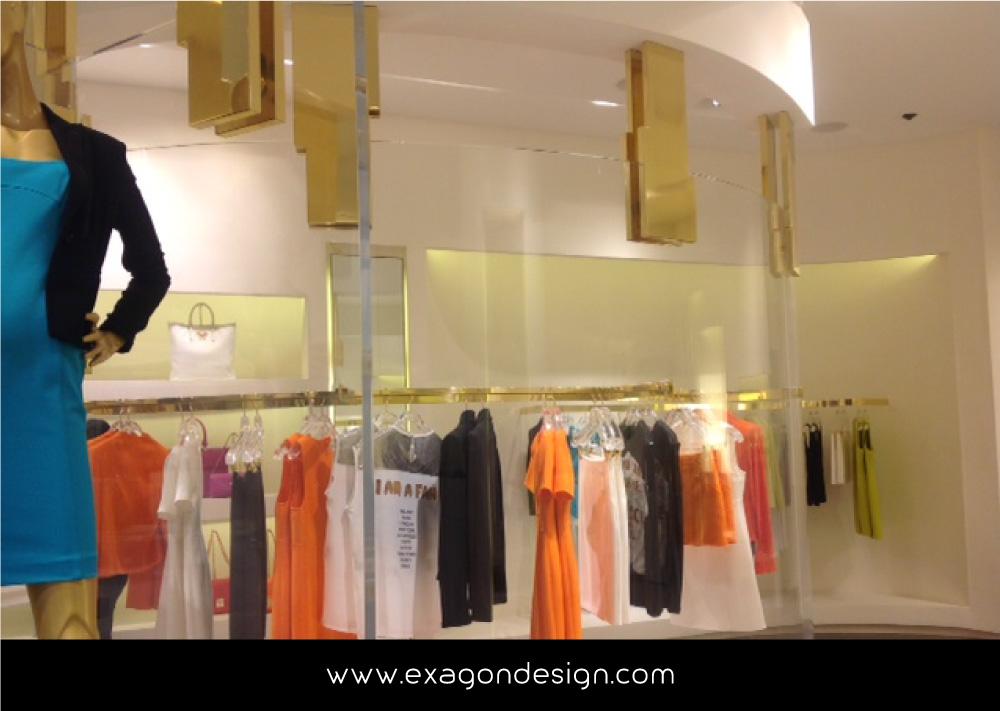 Versace-Tblisi-shop-flying-wardrobe-plexiglas-and-brass-exagon-design_09